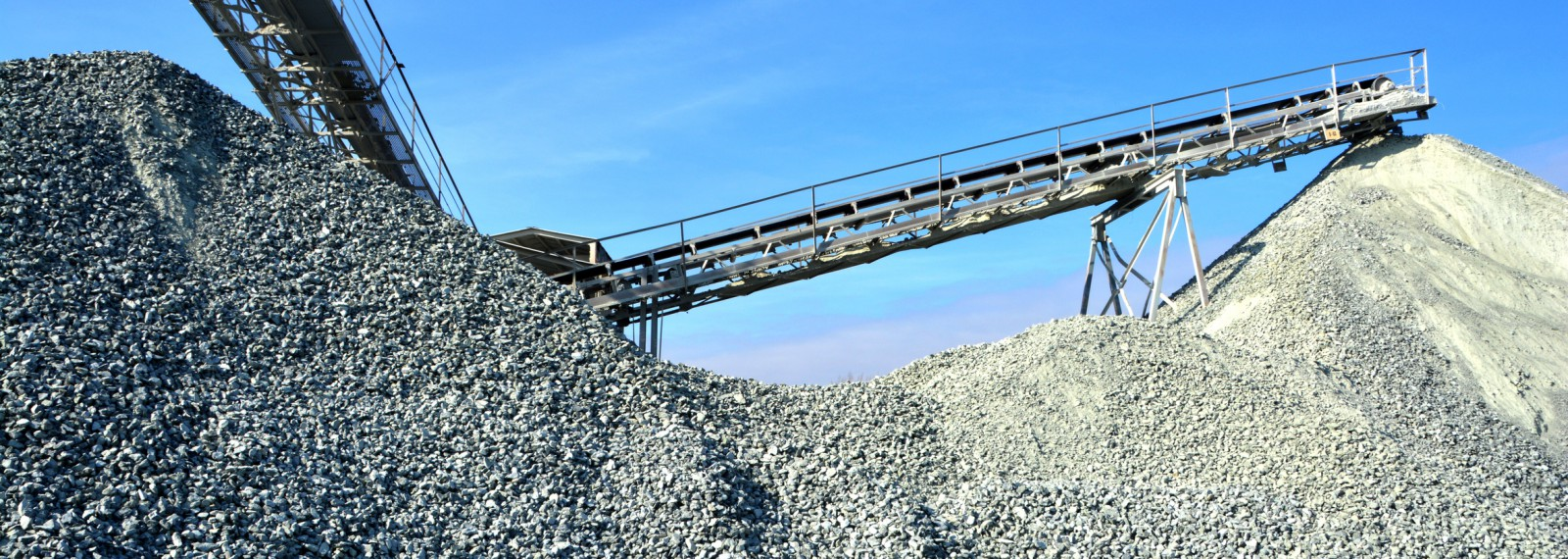 Heavy machinery of gravel production in quarry.